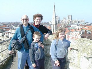 Family on ramparts of Cliffords Tower with York Minster in the background