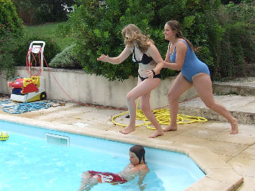 Alice pushes Eloise into the pool