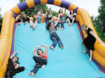 Kids chaos on the inflatable assault course