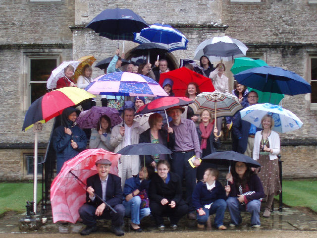Brollies to the front! The group musters on the steps of Rousham house.
