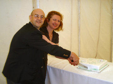 Andy and Helen cut the 20th anniversary cake