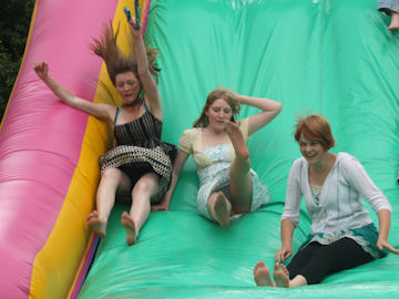Big girls on the inflatable slide