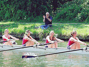 Spectator claps an Emma crew bedecked with foliage showing they got their bump