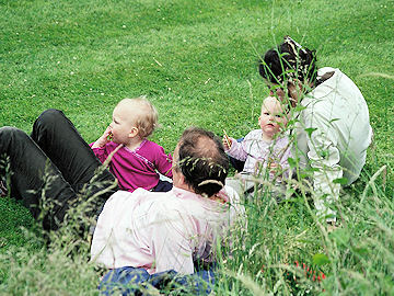 The Reed family relax on the lawn