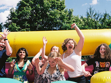 Teenagers on the bouncy castle